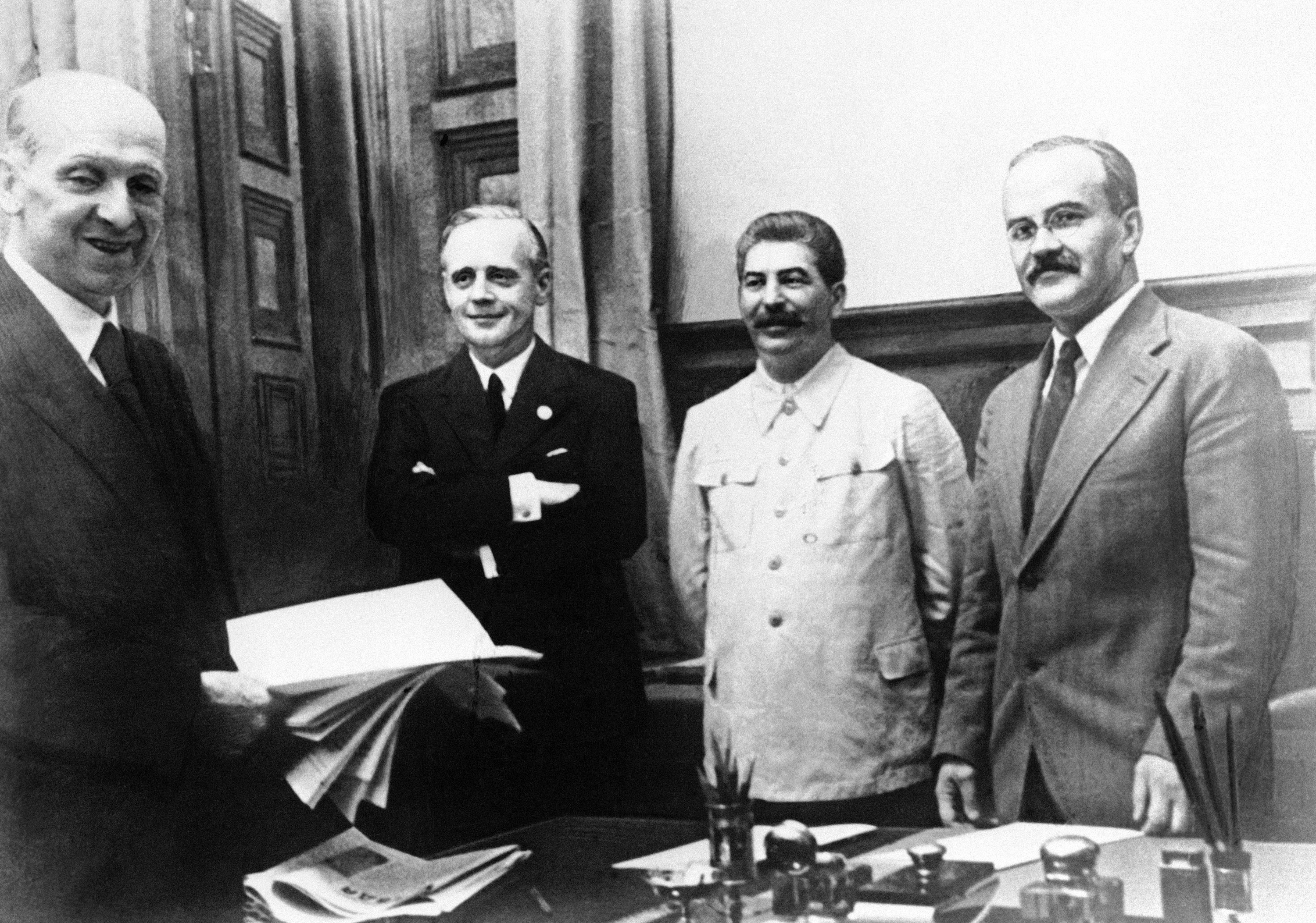 The scene in Moscow on August 23, 1939, after representatives of Nazi Germany and Soviet Russia signed their ten year Non Aggression Pact. Shown from left to right are: Freidrich Gaus, Joachim von Ribbentrop,Joseph Stalin , and Vyacheslav Molotov. Molotov signed for Russia and von Ribbentrop signed for Germany